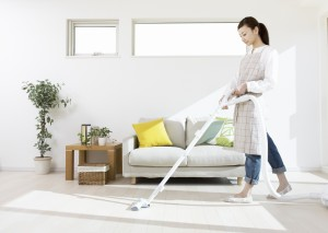 woman vacuuming floor